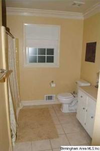 Bathroom Is Spacious And Adorned With Crown Molding Tile Flooring And Texturized Window
