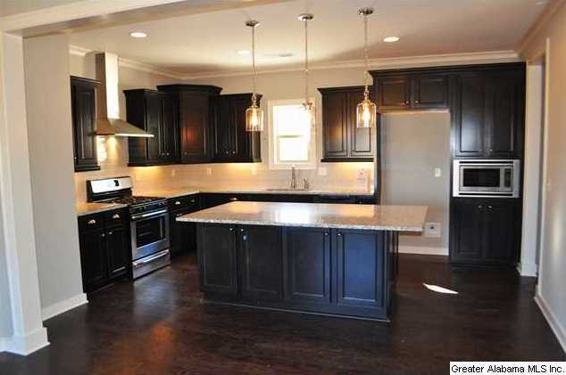 Check out this awesome kitchen this huge island has cabinets on