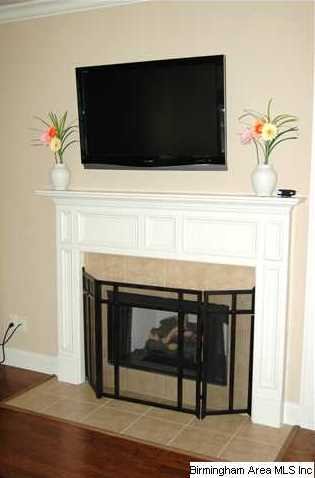 Cozy up to the gas fireplace and above is wired for a large flat