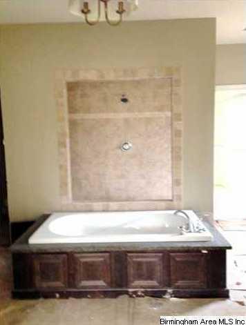 Custom bath has huge garden tub in center of bath with glass ...