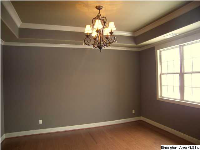 Dining room with elegant chandlier trey ceiling and crown for Crown molding ideas dining room