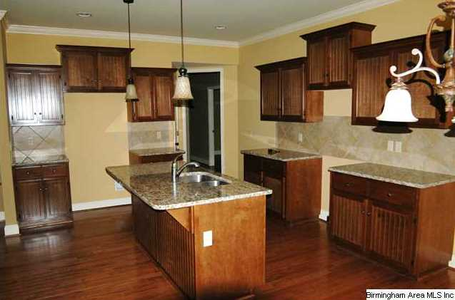 enjoy cooking in this large kitchen with hardwoods
