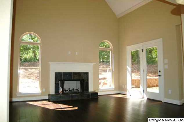 Keeping room off the kitchen has high vaulted ceiling, hardwoods and lots  of windows