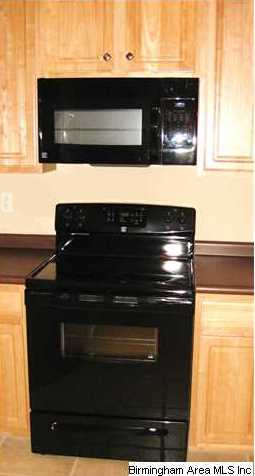 Kitchen Features Black Smooth Top Range Built In Microwave Dishwasher And Refrigerator