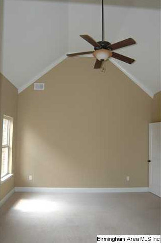 Master-bedroom-has-vaulted-ceiling-crown-molding-and-a-ceiling-fan ...