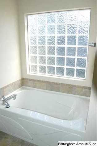 Pamper yourself with the large soaking tub with the Plastic glass block windows