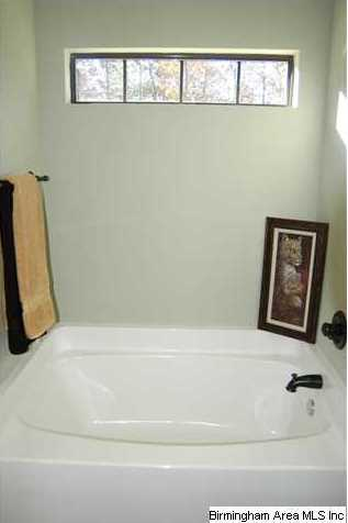 Relax in the large garden tub with oil rubbed fixtures for Oversized garden tub