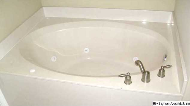 relax in the large jetted garden tub there is also a