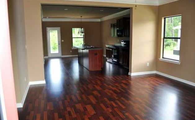 This open floor plan features two piece moldings in the living ...