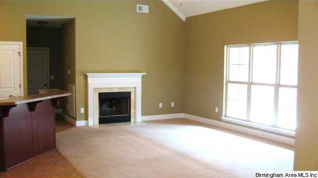 crown molding fireplace. Throw great football parties in this very open plan  Vaulted ceiling crown molding and fireplace are features of room
