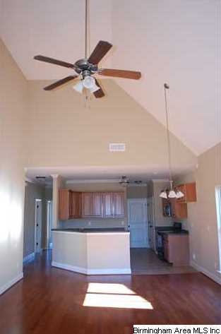 Vaulted ceiling and ceiling fan are also featured in the great room mozeypictures Gallery
