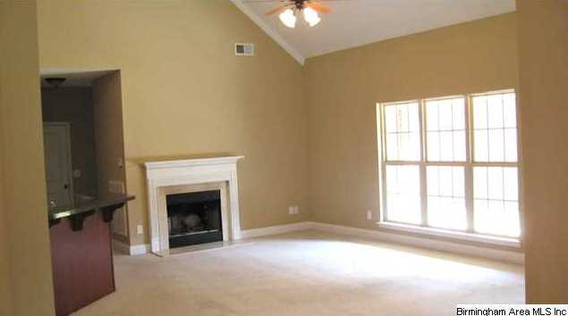 Vaulted ceiling and fireplace can be enjoyed from the living room